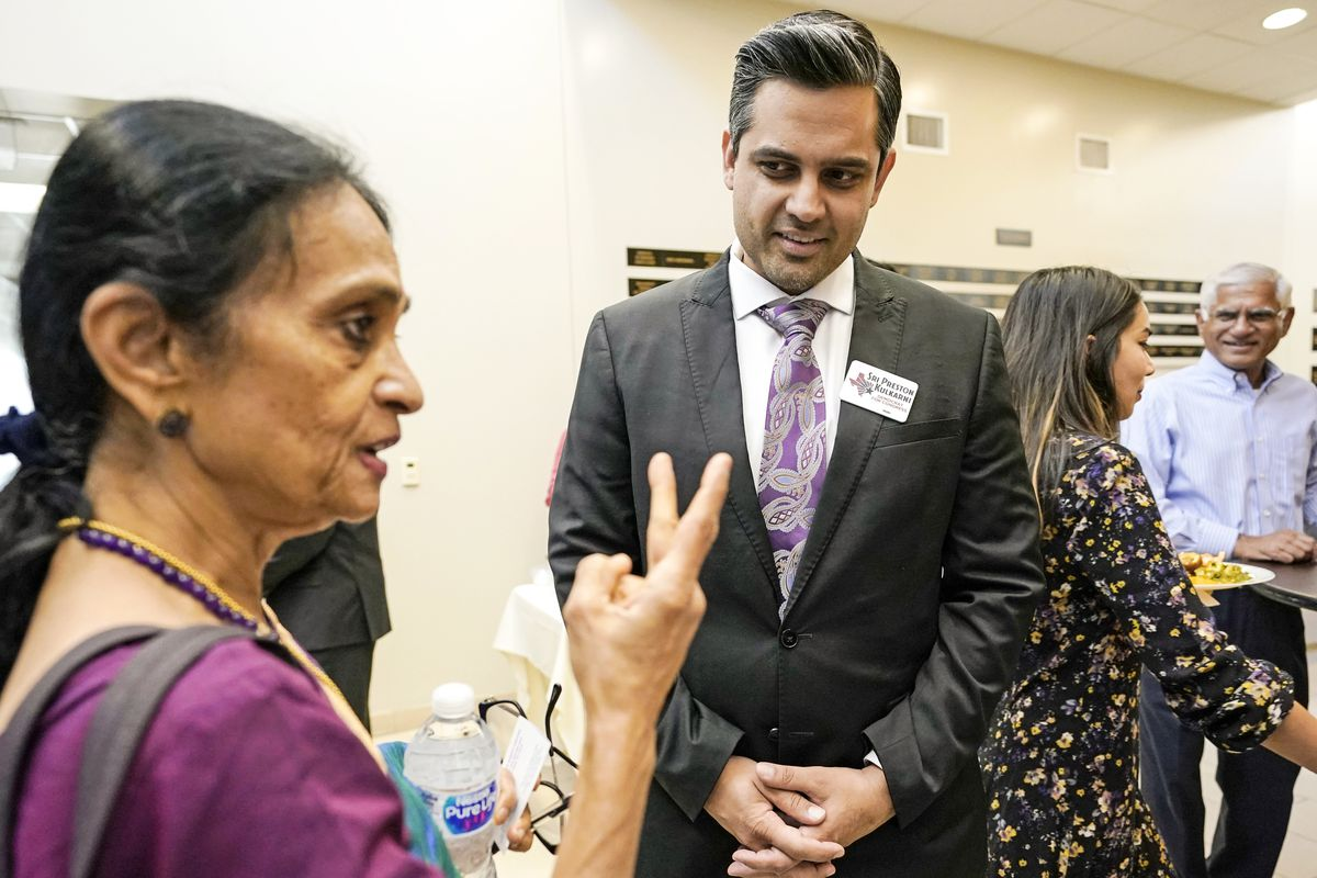 Thara Narasimhan (left) talks with Democrat for Congress candidate Sri Kulkarni during a fundraiser in Houston, Texas on July 29, 2018. Narasimhan, who hosts a local Hindu radio program, has already given $1,200 to the Democrat running against Republican