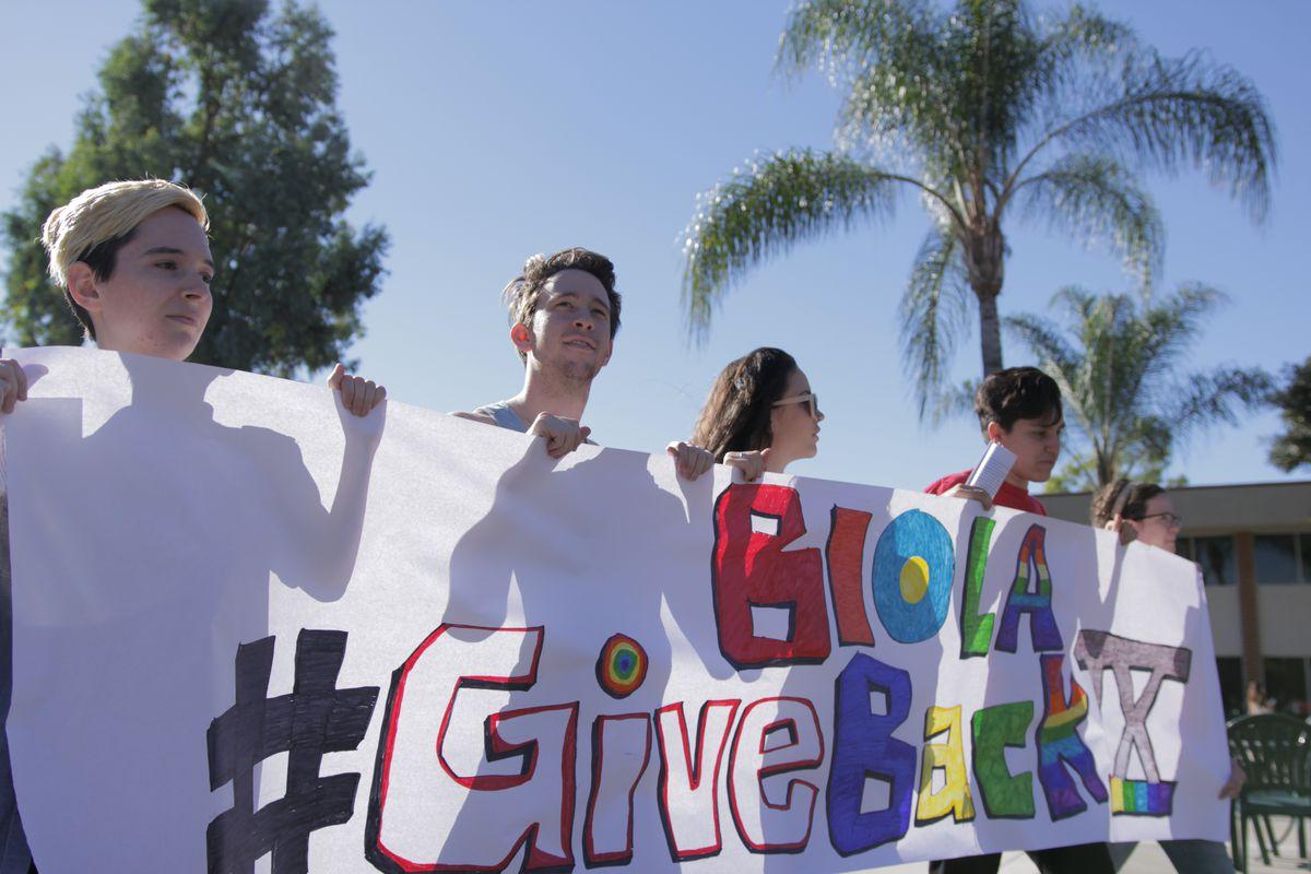 LGBTQ activists and allies protesting at Biola University Tuesday.