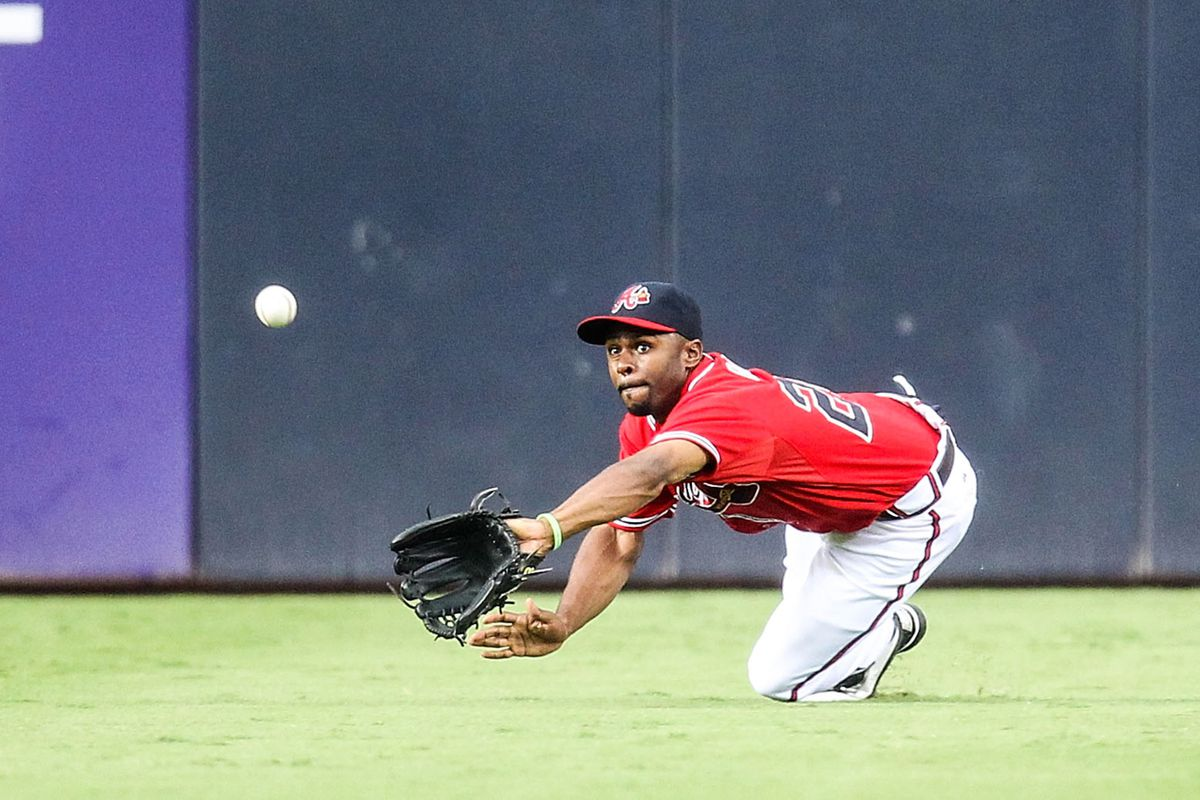 August 3, 2012; Atlanta, GA, USA; Atlanta Braves center fielder Michael Bourn (24) makes a diving stop in the first inning against the Houston Astros at Turner Field. Mandatory Credit: Daniel Shirey-US PRESSWIRE