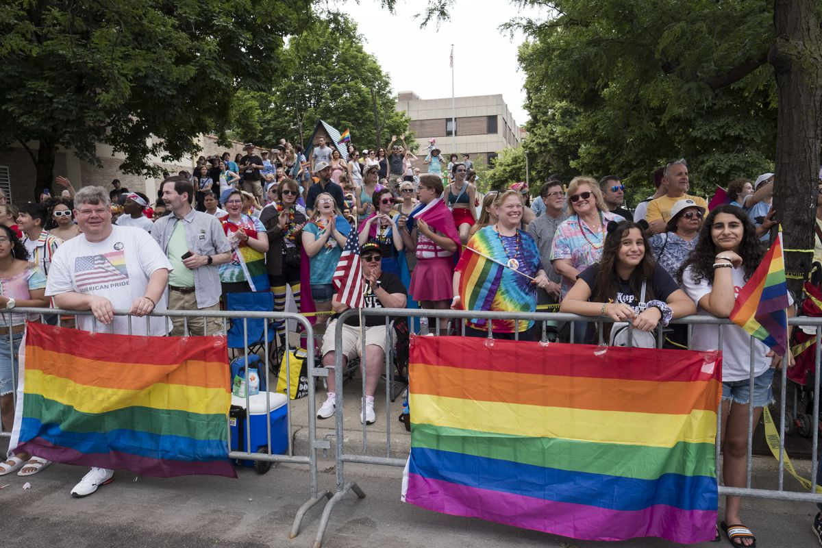 Spectators watching the 2019 Chicago Pride Parade.