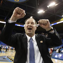 BYU head coach Jeff Judkins celebrates the team's 80-76 win against Nebraska in a second-round game of the NCAA women's college basketball tournament on Monday, March 24, 2014, in Los Angeles. (AP Photo/Jae C. Hong)