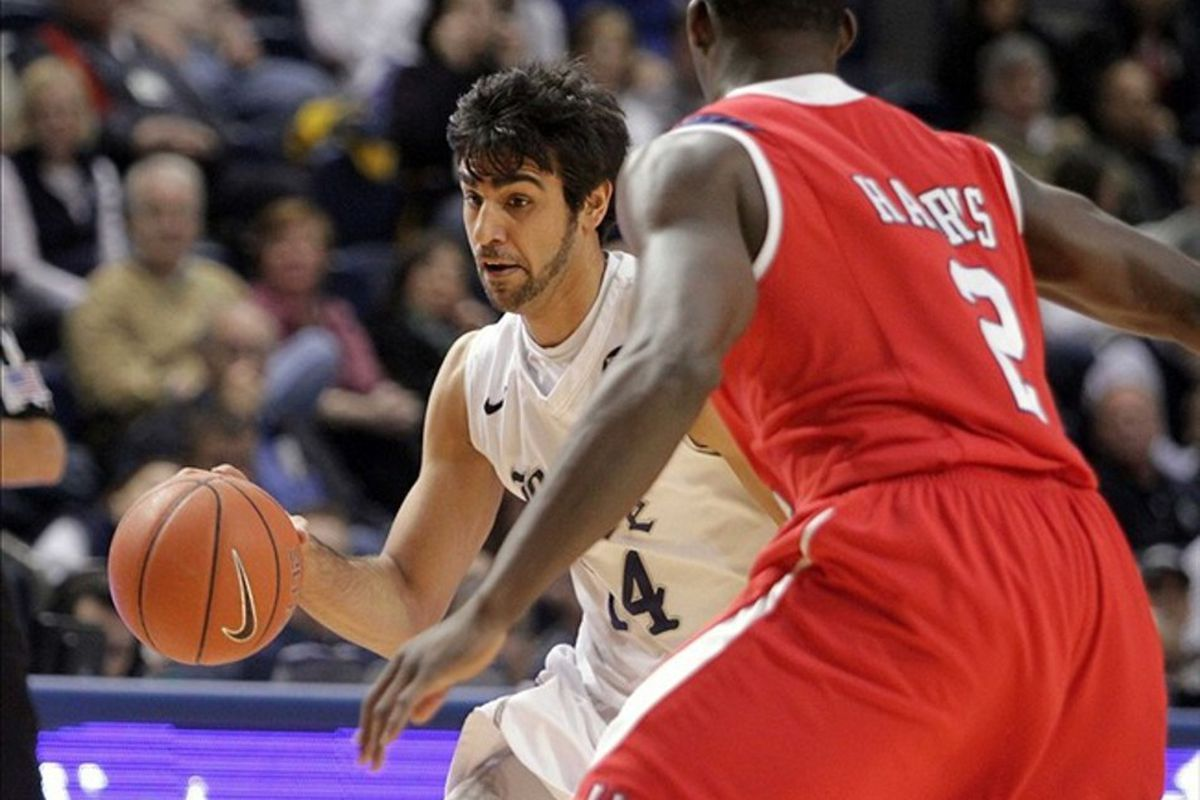 March 03, 2012; Houston, TX, USA; Rice Owls forward Arsalan Kazemi (14) drives to the basket against the Houston Cougars in the first half at Tudor Fieldhouse. Mandatory Credit: Troy Taormina-US PRESSWIRE