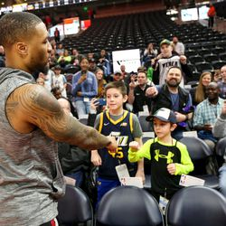 Portland Trail Blazers guard Damian Lillard (0) greets Braden Markham, 10, and Carson Markham, 7, before the game against the Utah Jazz at Vivint Smart Home Arena in Salt Lake City on Friday, Feb. 7, 2020.