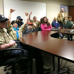 Members of Boy Scouts of America waves goodbye to a person on the other end of a videophone call at the Sorenson Communications Headquarters Tuesday, Dec. 30, 2014, in Salt Lake City.