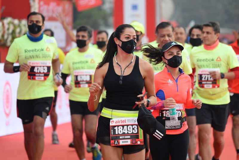 Runners wear face masks as they take part in the Airtel Delhi Half Marathon 2017 in New Delhi on November 19, 2017. Photo Credit: Sajjad Hussain/AFP/Getty Images.