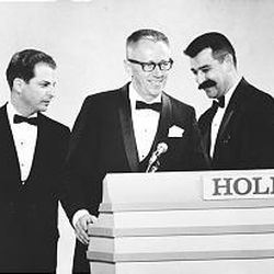 """Lee Mendelson, left, Charles Schulz and Bill Melendez accept the Emmy for best network animated special in 1966 for """"A Charlie Brown Christmas."""""""