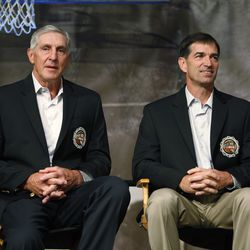 Former Utah Jazz guard John Stockton, right, and former Utah Jazz head coach Jerry Sloan sit next to each other before their enshrinement in the Basketball Hall of Fame in Springfield, Massachusetts, Sept. 11, 2009.