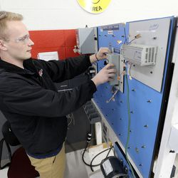 Elijah Stanger finishes up working on electrical motor controls during automation and robotics class at Davis Technical College in Kaysville on Wednesday, Jan. 29, 2020.