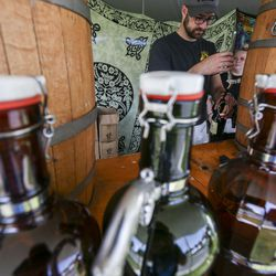 Cameron Retallick pours root beer at the Camp Canteen tent during the Utah Renaissance Faire at Thanksgiving Point's Electric Park in Lehi on Friday, Aug. 23, 2019. Camp Canteen, which brews it own root beer called Bison Brew, anticipate selling 1,000 gallons over the two-day event.