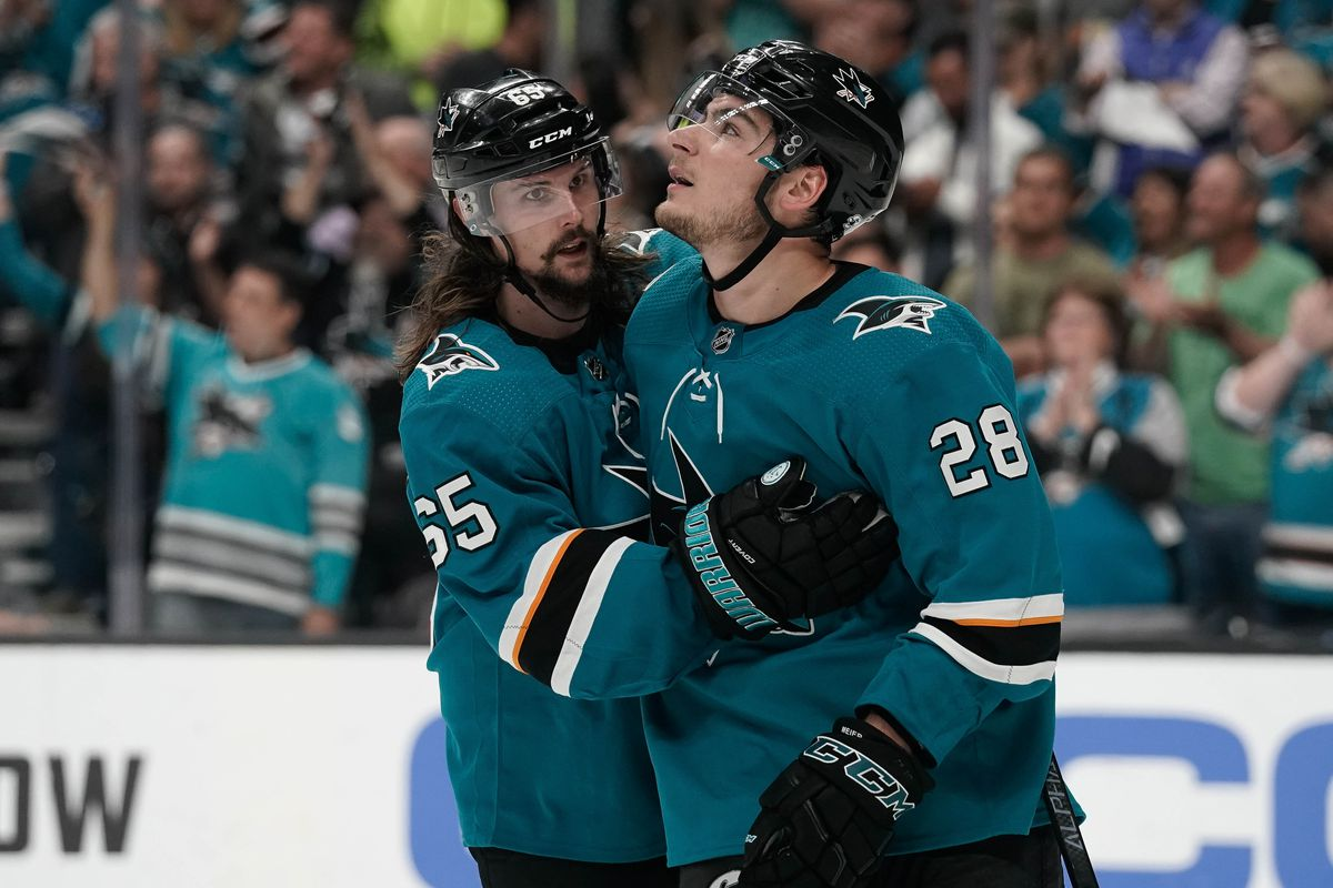 Apr 23, 2019; San Jose, CA, USA; San Jose Sharks defenseman Erik Karlsson (65) speaks with right wing Timo Meier (28) during the third period in game seven of the first round of the 2019 Stanley Cup Playoffs against the Vegas Golden Knights at SAP Center