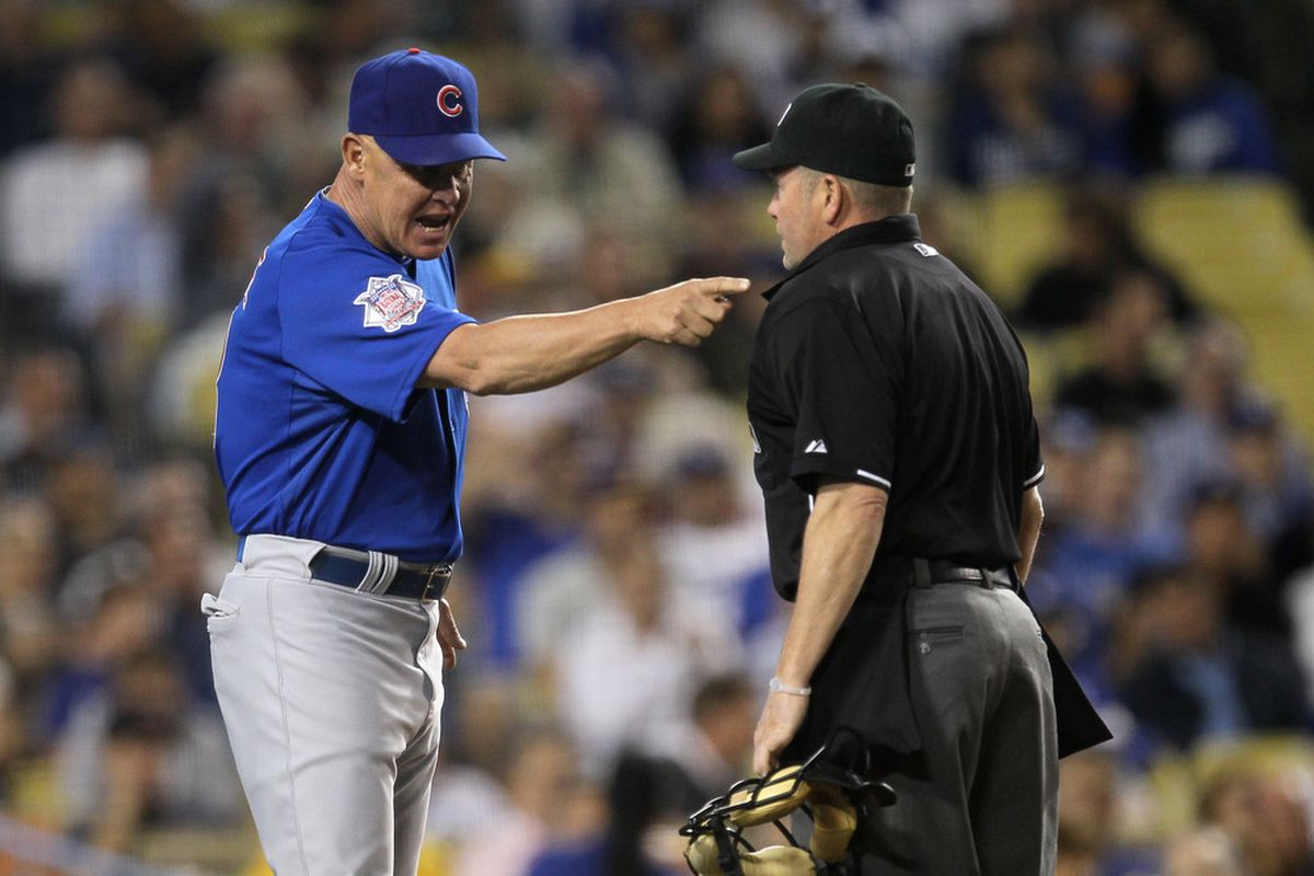 Manager Mike Quade of the Chicago Cubs argues with home plate umpire Jerry Meals in the game with the Los Angeles Dodgers on May 2, 2011 at Dodger Stadium in Los Angeles, California.  (Photo by Stephen Dunn/Getty Images)