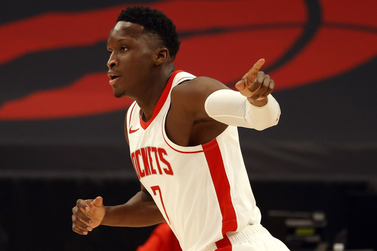 Houston Rockets guard Victor Oladipo point as he makes a three point basket against the Toronto Raptors during the first half at Amalie Arena.