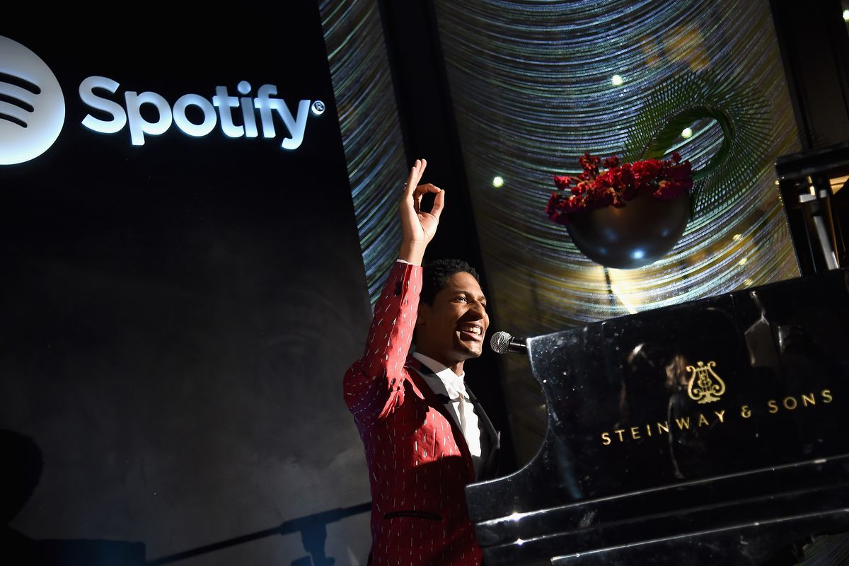 Jon Batiste performs at a piano onstage for Spotify.