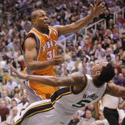 Utah Jazz guard Devin Harris (5) draws an offensive foul on Phoenix Suns guard Sebastian Telfair (31) as the Utah Jazz and the Phoenix Suns play Tuesday, April 24, 2012 in Energy Solutions arena.