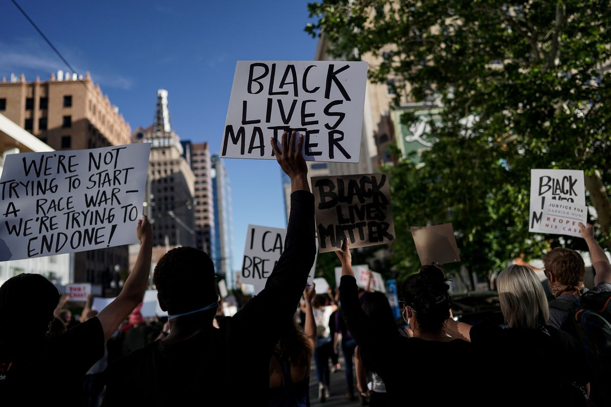 Protesters denouncing racism and police brutality march through downtown Salt Lake City on Tuesday, June 9, 2020.