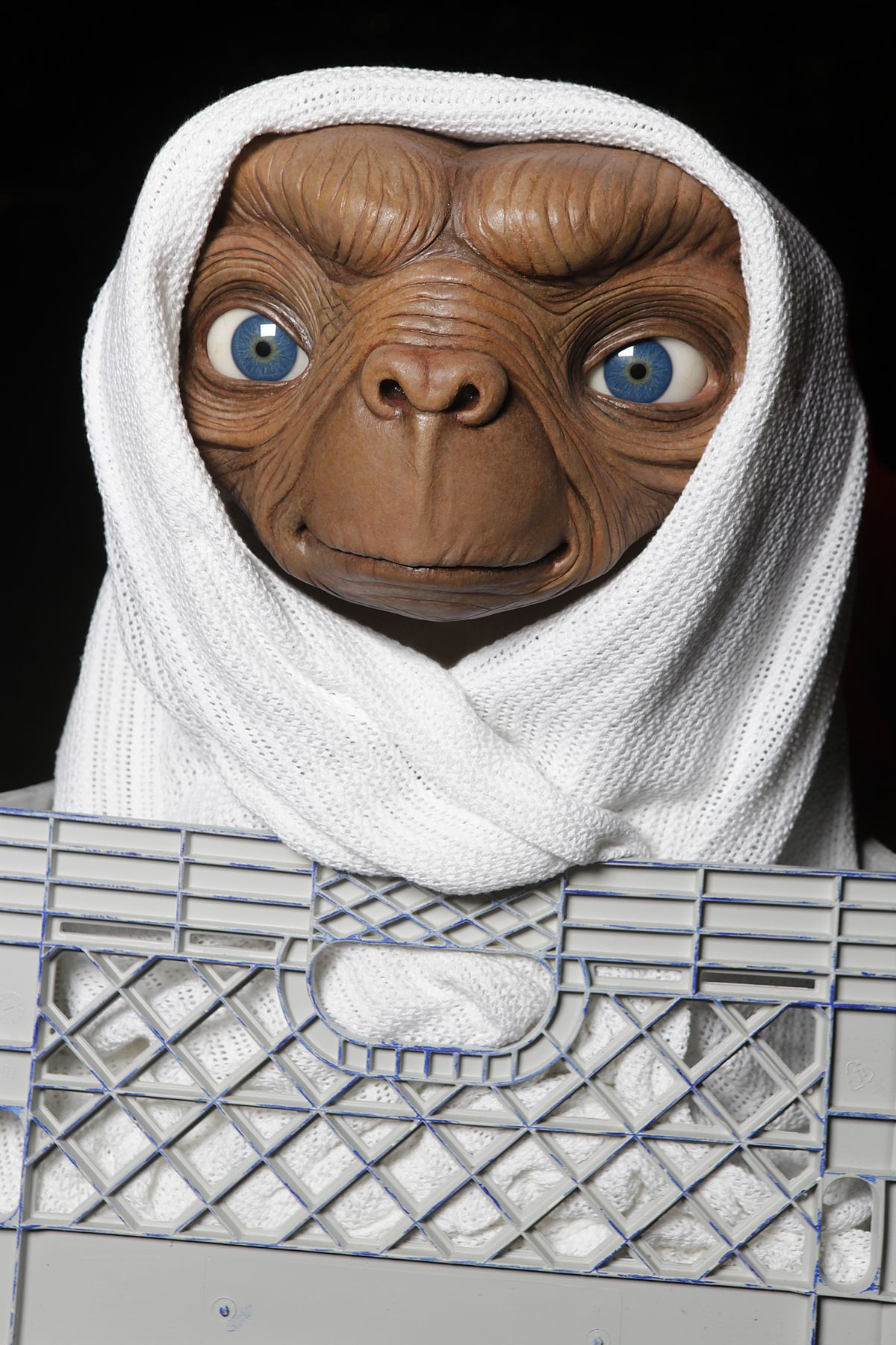 Studio Artist Rides E.T. Figure To Its New Home In The Film Experience At Madame Tussauds New York For The Anniversary of Universal Studios/Amblin Entertainment's 'E.T. The Extra-Terrestrial'