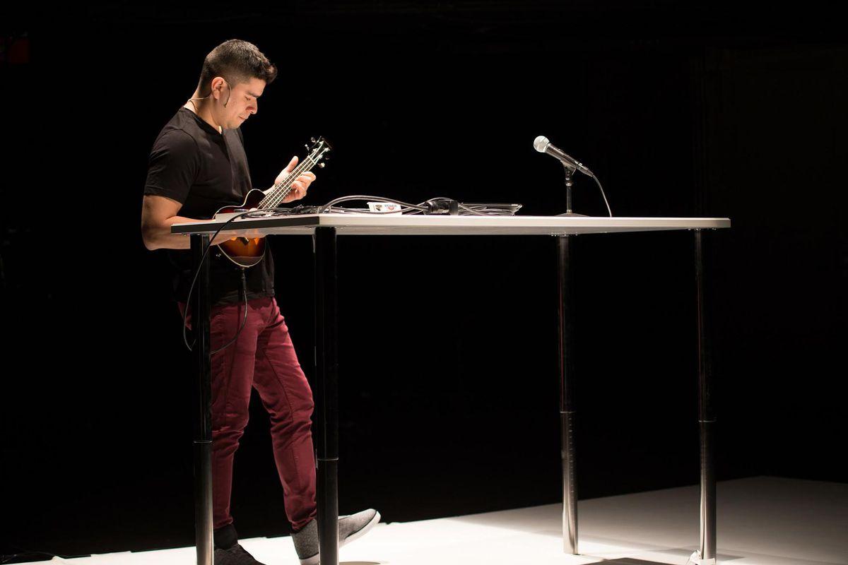 "Brian Quijada in his one-man Teatro Vista show ""Where Did We Sit on the Bus?"" Joel Maisonet photo"