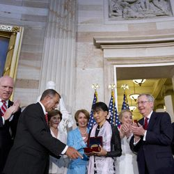 Myanmar democracy leader Aung San Suu Kyi, center, receives the Congressional Gold Medal from Speaker of the House John Boehner, at the U.S. Capitol in Washington, Wednesday, Sept. 19, 2012, as Rep. Joseph Crowley, D-N.Y., former first lady Laura Bush, back left, House Democratic Leader Nancy Pelosi, Secretary of State Hillary Rodham Clinton, Senate Republican Leader Mitch McConnell, and Senate Majority Leader Harry Reid, watch