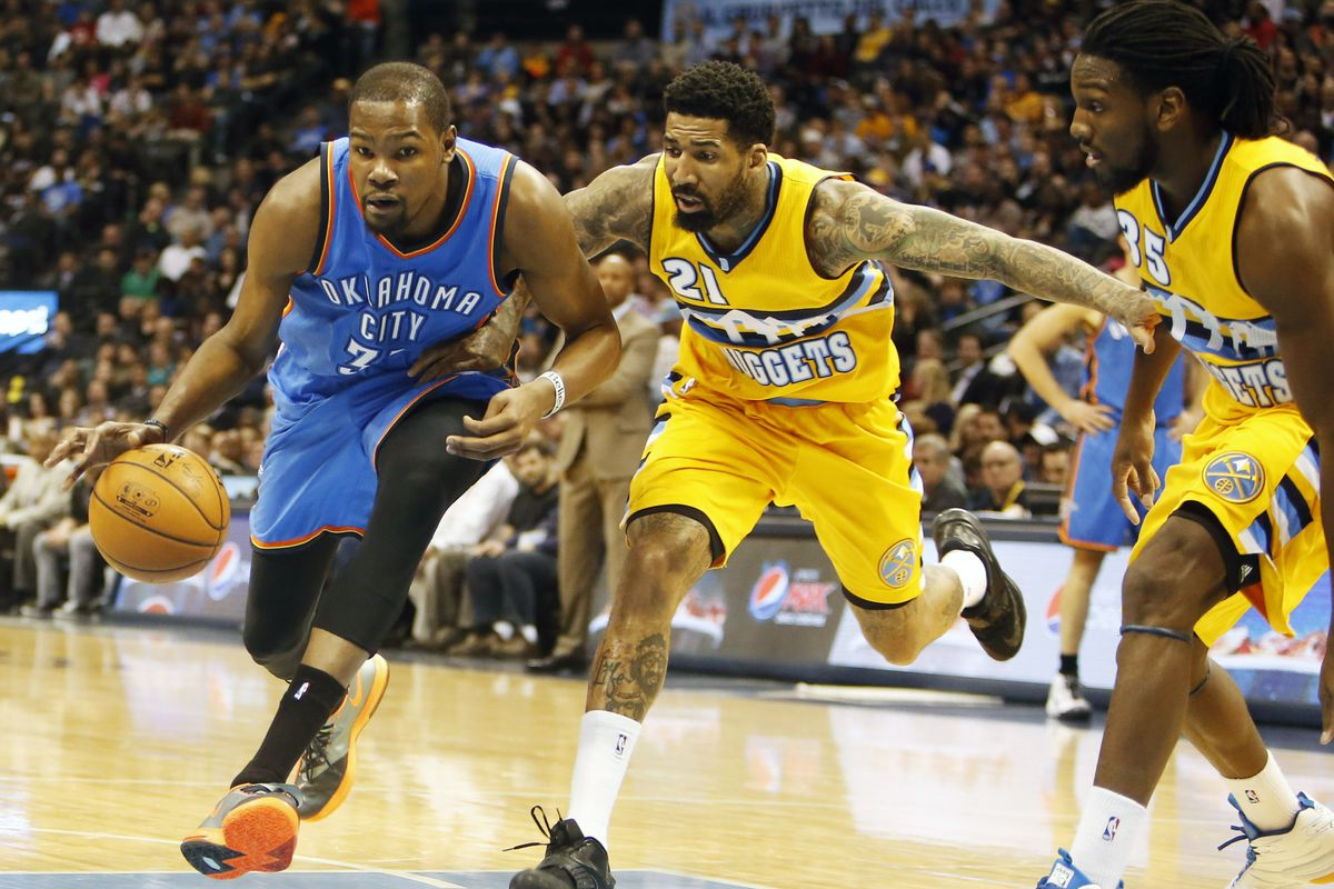 Kevin Durant drives past Wilson Chandler