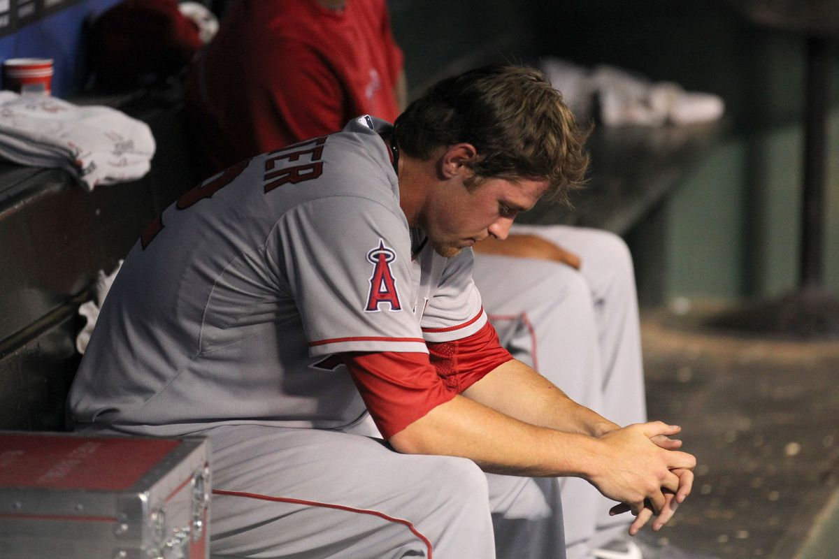 Aug 2, 2012; Arlington, TX, USA; Los Angeles Angels relief pitcher David Carpenter (52) reacts in the dugout after getting pulled in the seventh inning against the Texas Rangers at Rangers Ballpark.  Mandatory Credit: Matthew Emmons-US PRESSWIRE