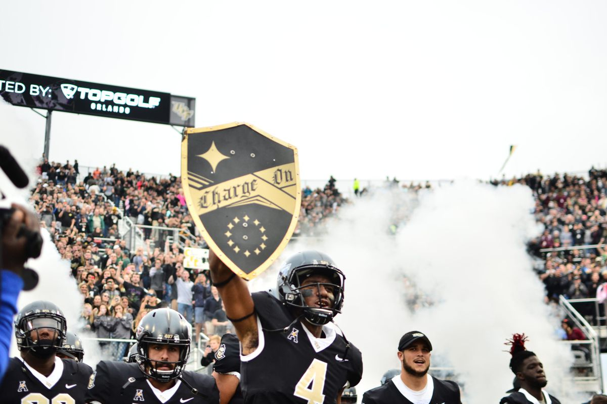Tre'Quan Smith carries out the Charge On Shield before the USF game (Photo: Derek Warden)