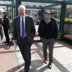 Chris Hansen, right, the venture capitalist who wants to build a new sports arena in Seattle, walks with Seattle Mayor Mike McGinn, left, as they prepare to talk to reporters, Thursday, April 5, 2012, in Seattle. Hansen said he will pay for a study to determine the impacts on traffic and parking around his proposed stadium site south of Seattle and near Safeco Field and CenturyLink Field where the MLB Seattle Mariners and the NFL Seattle Seahawks play.