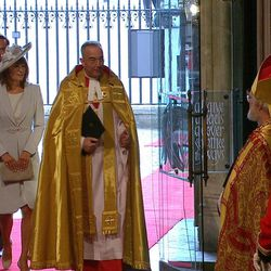 In this image taken from video, Carole Middleton, Kate Middleton's mother, second left, and James Middleton, Kate Middleton's brother, left, walk with the Dean of Westminster John Hall, center, as they arrive at Westminster Abbey for the Royal Wedding in London on Friday, April, 29, 2011.