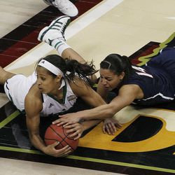 Notre Dame guard Skylar Diggins (4) and Connecticut guard Bria Hartley (14) vie for a loose ball during the second half of the NCAA women's Final Four semifinal college basketball game, in Denver, Sunday, April 1, 2012. Notre Dame won 83-75.