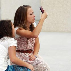 Malori and Marissa Gonzales take photos of the Ogden Utah Temple in Ogden, Tuesday, July 29, 2014.