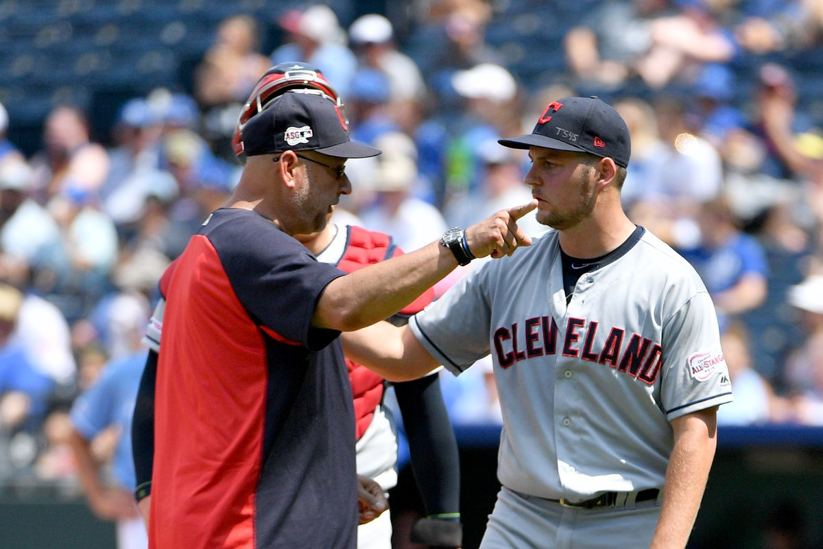 Cleveland Indians manager Terry Francona (77) gestures toward the dugout at starting pitcher Trevor Bauer (47) in the fifth inning against the Kansas City Royals at Kauffman Stadium. Mandatory Credit: Denny Medley