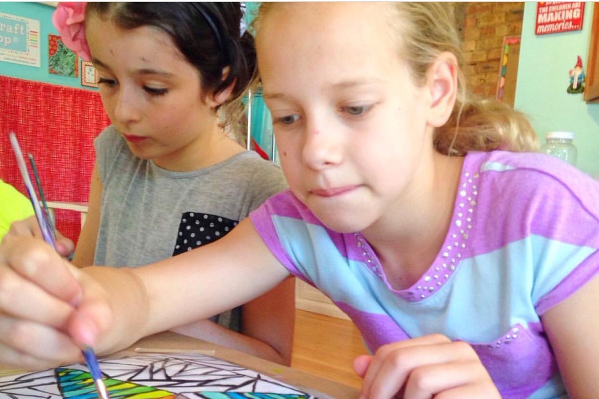 Children work on arts projects at Wishcraft Workshop in the North Center neighborhood, where plans for the summer are in flux due to the coronavirus.