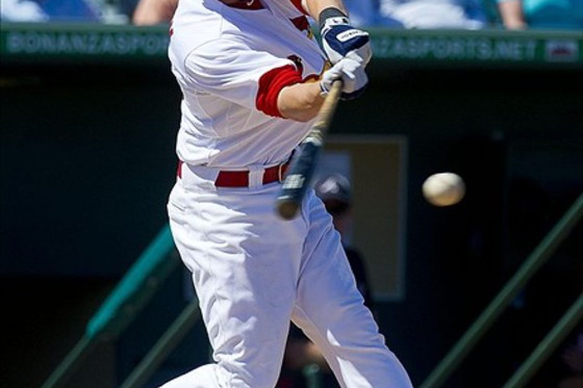 Mar 12, 2012; Jupiter, FL. USA; St. Louis Cardinals shortstop Ryan Jackson (88) connects for a base hit against the Atlanta Braves at Roger Dean Stadium. The Cardinals defeated the Braves 5-4. Mandatory Credit: Scott Rovak-US PRESSWIRE