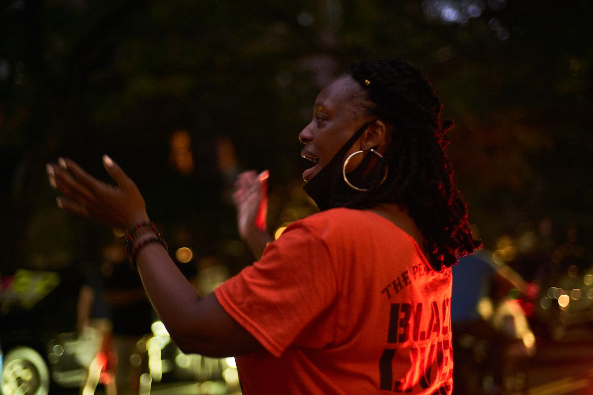 """""""I wanted to go to protests, but was worried about COVID, so we brought the protest to our block,"""" said Trina Fowler about helping to organizer Black Lives matter solidarity demonstrations on St. John's Place in Prospect Heights, Brooklyn, Aug. 8, 2020."""