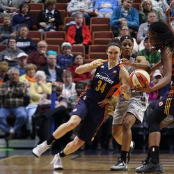 Connecticut Sun's Kelly Faris (34) comes to get the ball from Jonquel Jones (35).