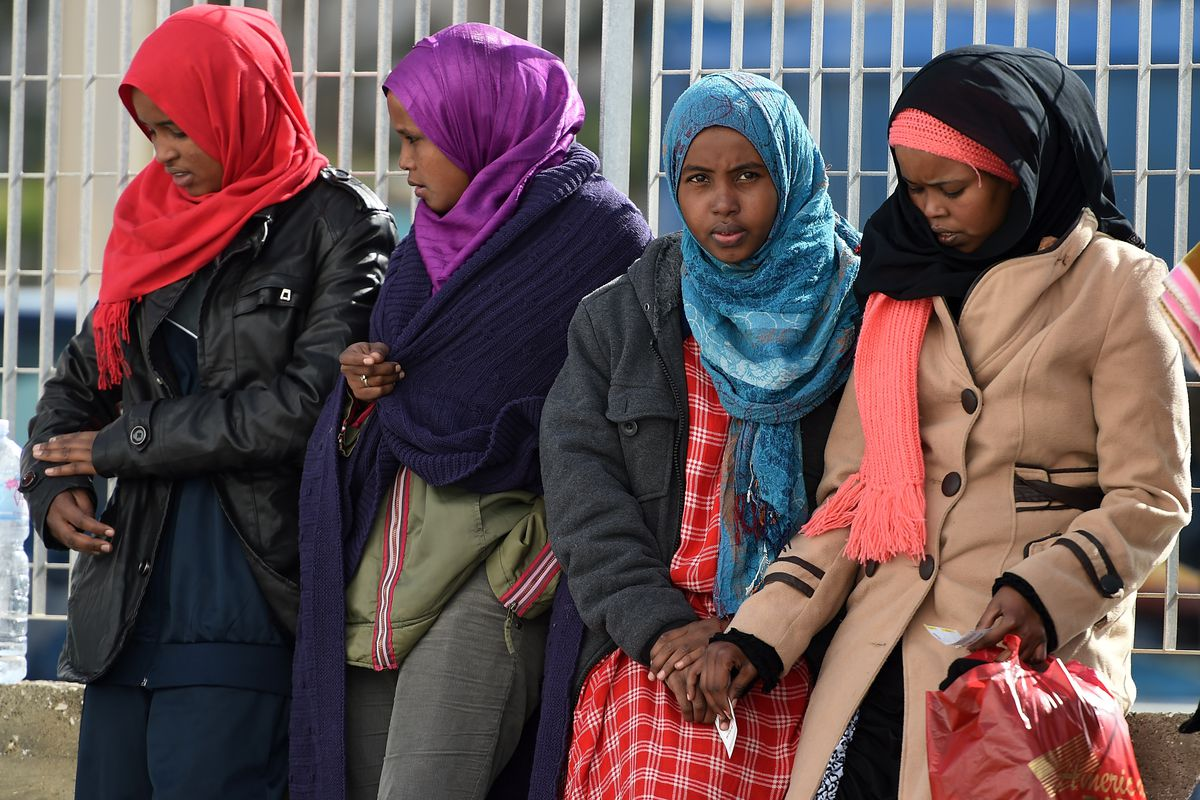 Migrants wait to board a ship on February 20, 2015, in Lampedusa, Italy. Hundreds of migrants recently arrived in Lampedusa after fleeing the attacks by ISIS in Libya.