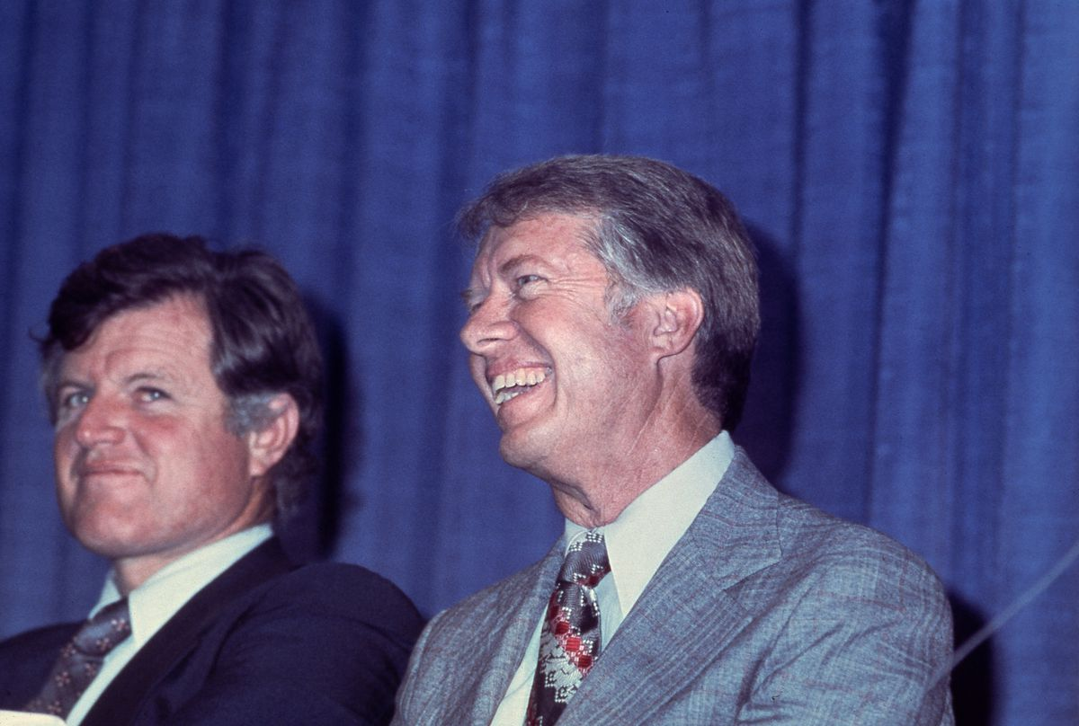 Ted Kennedy on the left looking bemused, Carter smiling on the right