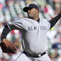New York Yankees pitcher CC Sabathia throws against the Minnesota Twins during the first inning of a baseball game, Wednesday, Sept. 26, 2012 in Minneapolis.
