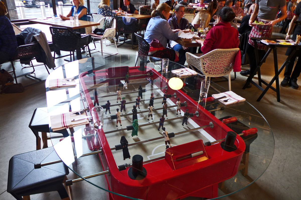 You can almost pay foosball as you dine.