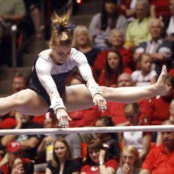Utah State's Sarah Landes performs on the bars at the NCAA Salt Lake Regional Gymnastics Saturday, April 7, 2012 in Salt Lake City.