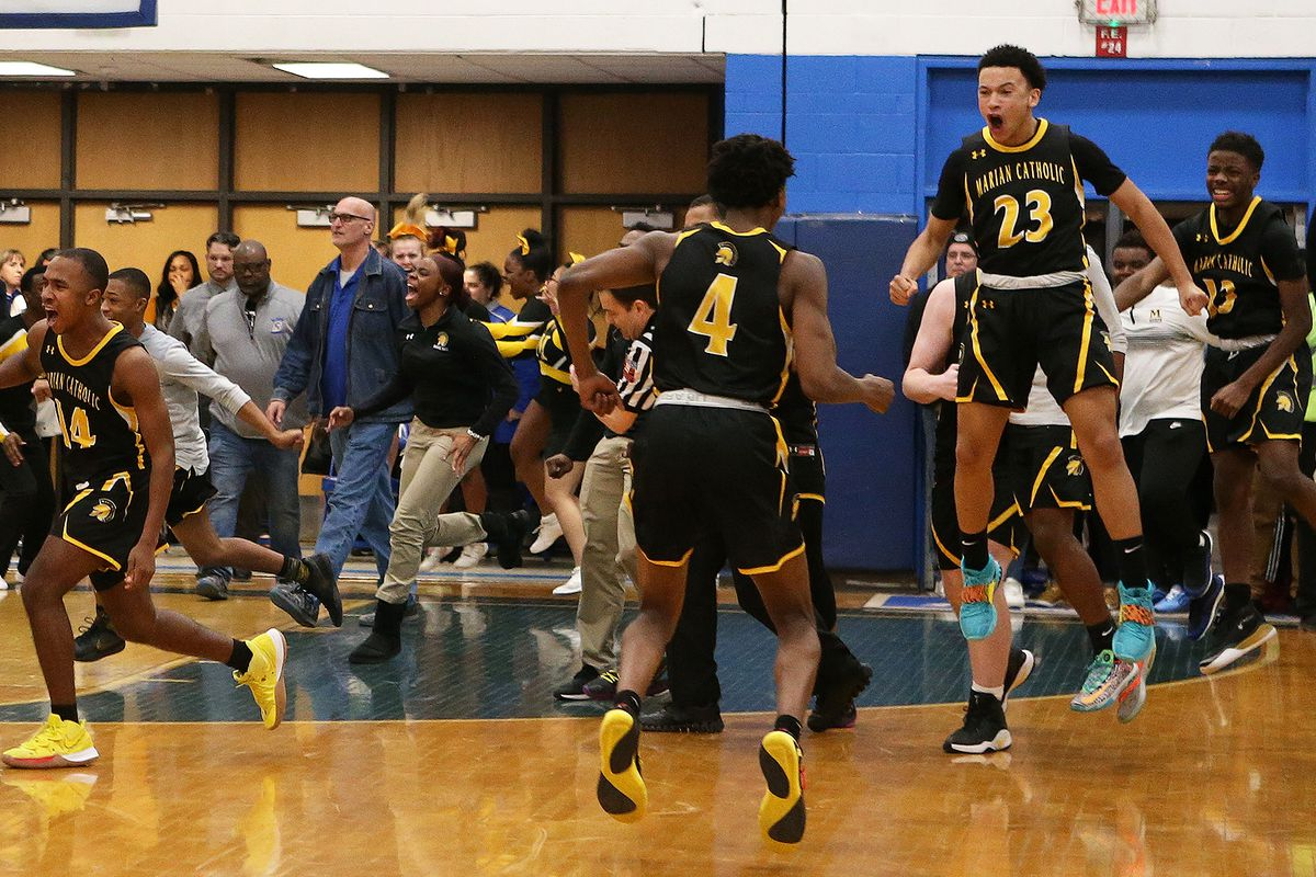 Marian Catholic's bench celebrates as the Spartans defeat next-door neighbor Bloom.