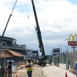 11:31 a.m. Crane operating on the Clark Street side of the triangle lot -