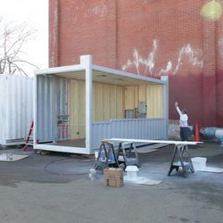 The first proxy shipping containers get ready for transportation to Hayes Valley