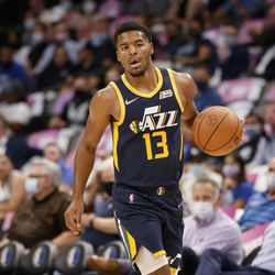 Utah Jazz's Jared Butler handles the ball in the first half of a preseason NBA basketball game against the Dallas Mavericks in Dallas, Wednesday, Oct. 6, 2021.