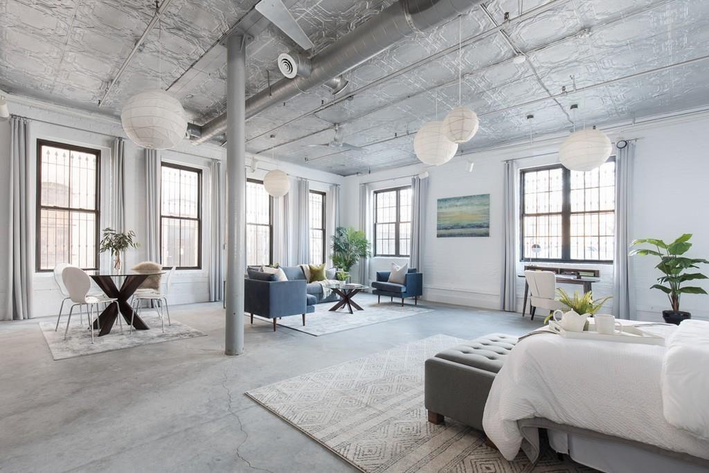An open bedroom facing that open living room.