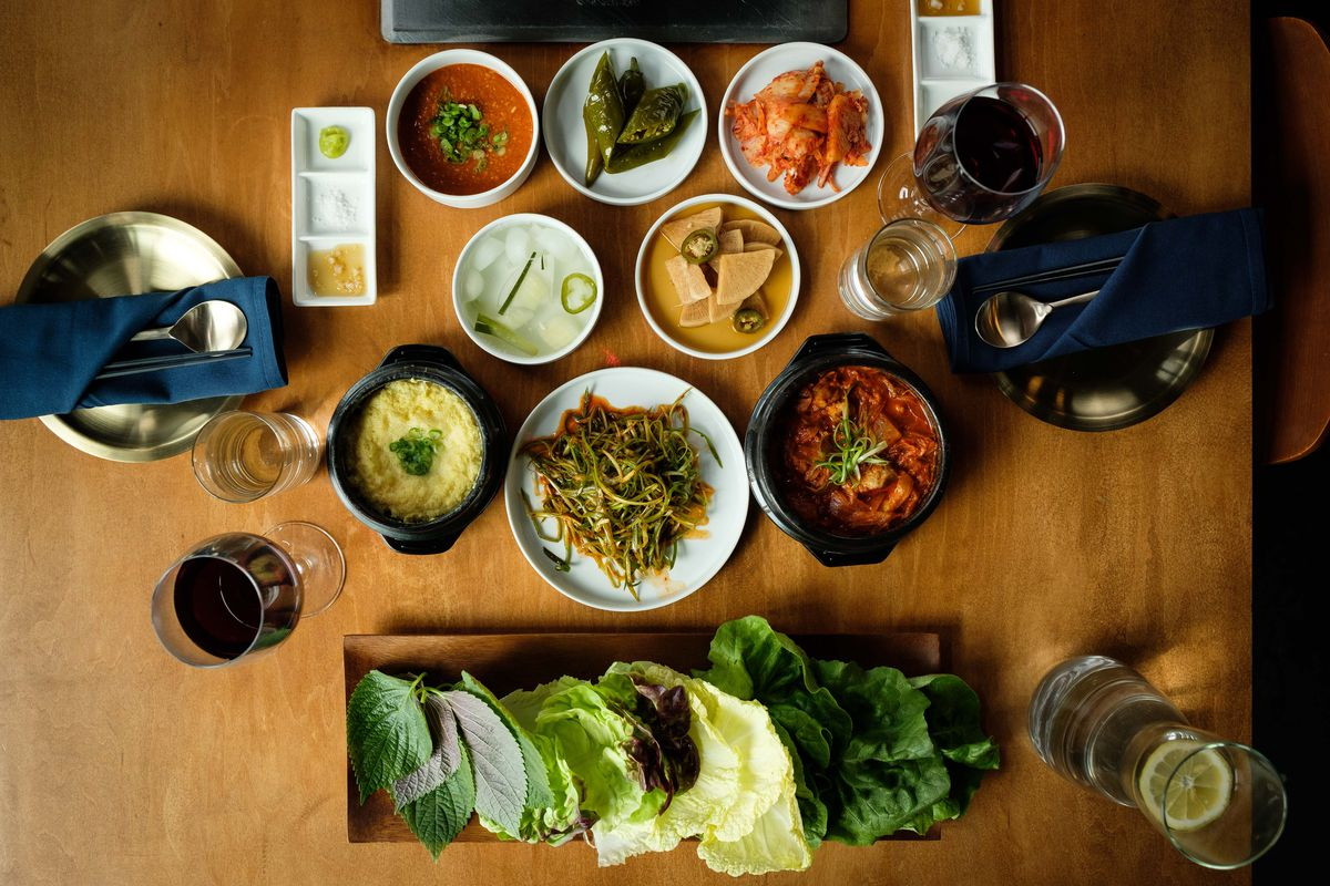 A selection of banchan, including kimchi and lettuce for ssam.