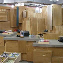 Behind the registers exist a massive blockade of wooden cubes to keep the privacy of the fitting rooms.