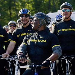 Former NFL great Bo Jackson, center, talks with other riders as he prepares for his 300-mile bike ride to benefit tornado victims in Alabama in Henager, Ala., Tuesday, April 24, 2012. The ride is going to go through rural areas and communities hit hard by tornadoes last April 27.  Jackson hopes to raise $1 million for the governor's relief fund and to raise awareness for those still in need.