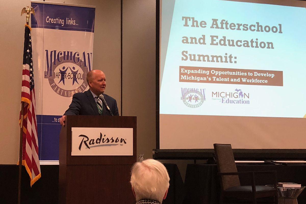 Matt Gillard, president of advocacy group Michigan's Children, addresses advocates in Lansing on April 16.