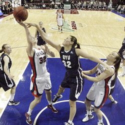 Brigham Young Cougars forward Dani Peterson (32) blocks the shot by Gonzaga Bulldogs forward Kayla Standish (32)  in the West Coast Conference finals in Las Vegas  Monday, March 5, 2012.  BYU won the title and will advance to the NCAA tournament.