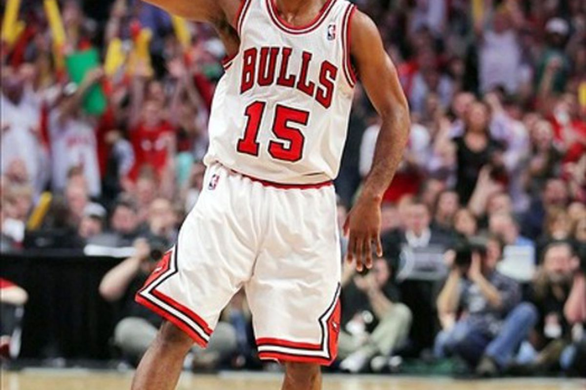 Mar 14, 2012; Chicago, IL, USA; Chicago Bulls point guard John Lucas (15) celebrates after scoring a three-point shot in the first half against the Miami Heat at the United Center. Mandatory Credit: Dennis Wierzbicki-US PRESSWIRE
